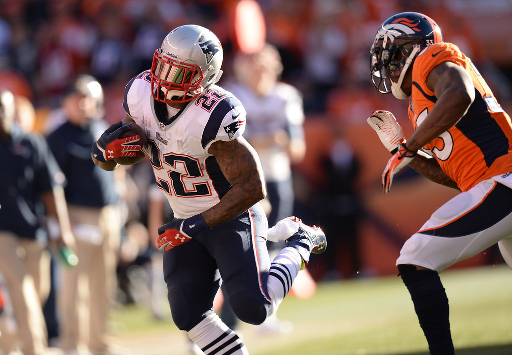 Description of . New England Patriots running back Stevan Ridley (22) makes a run in the third quarter. The Denver Broncos take on the New England Patriots in the AFC Championship game at Sports Authority Field at Mile High in Denver on January 19, 2014. (Photo by Hyoung Chang/The Denver Post)