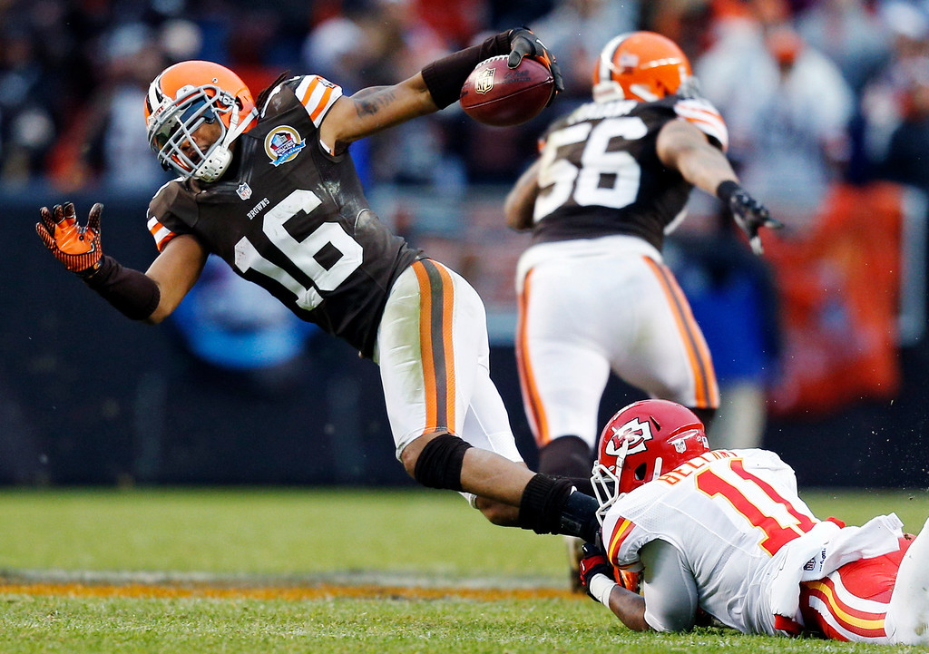 Description of . Cleveland Browns\' Josh Cribbs (16) is tripped up by Kansas City Chiefs\' Josh Bellamy on a fourth-quarter punt return in an NFL football game in Cleveland, Sunday, Dec. 9, 2012. The Browns won 30-7. (AP Photo/Rick Osentoski)