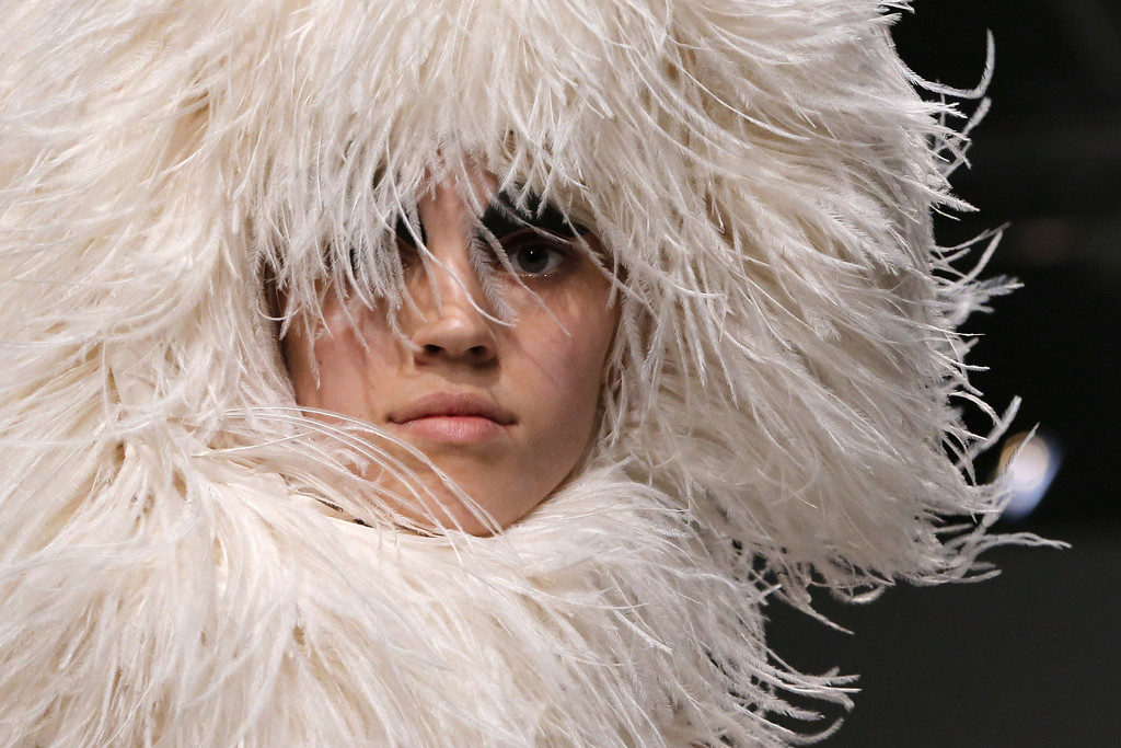 Description of . A model presents a creation as part of British fashion designer Gareth Pugh's ready-to-wear Spring/Summer 2014 fashion collection presented in Paris, Wednesday, Sept. 25, 2013. (AP Photo/Jacques Brinon)