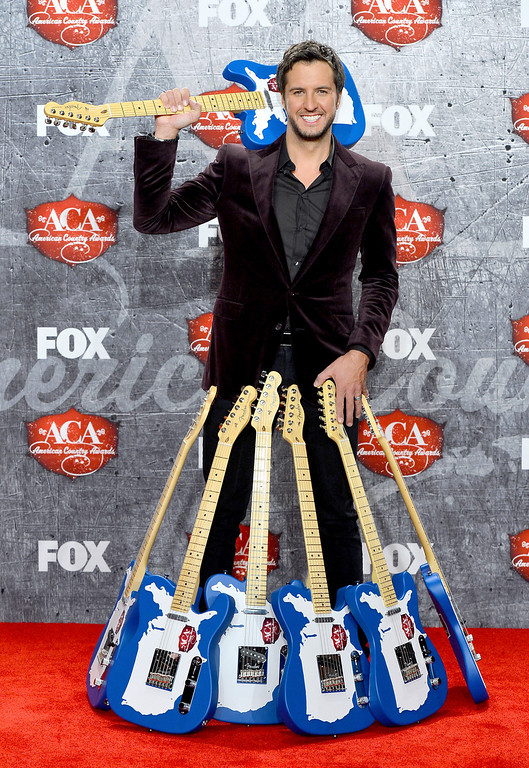 Description of . LAS VEGAS, NV - DECEMBER 10:  Singer Luke Bryan poses in the press room with multiple awards during the 2012 American Country Awards at the Mandalay Bay Events Center on December 10, 2012 in Las Vegas, Nevada.  (Photo by Frazer Harrison/Getty Images)