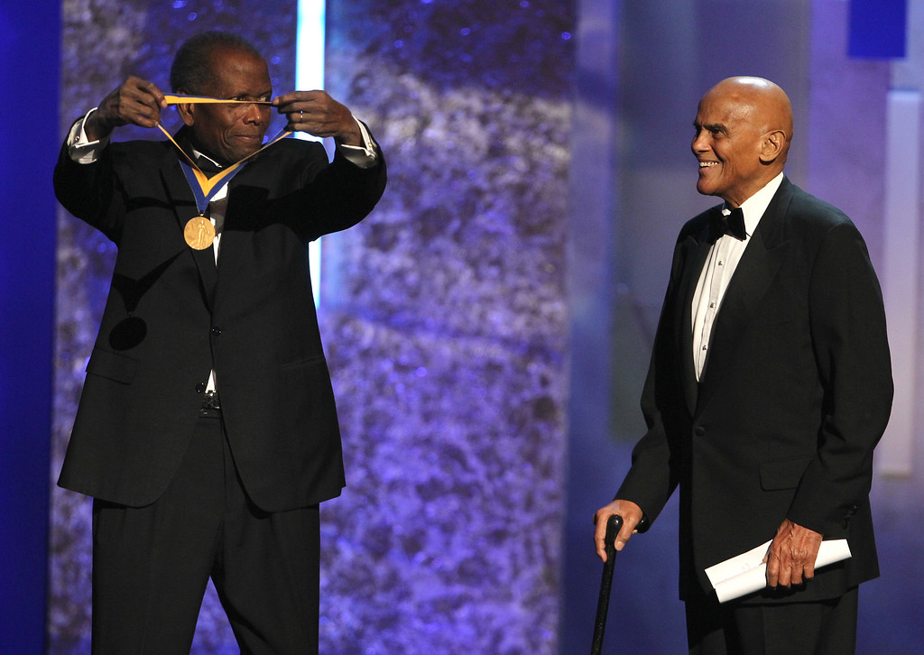 Description of . Sidney Poitier, left, presents the Spingarn award to Harry Belafonte at the 44th Annual NAACP Image Awards at the Shrine Auditorium in Los Angeles on Friday, Feb. 1, 2013. (Photo by Matt Sayles/Invision/AP)