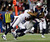 New England Patriots running back Stevan Ridley (22) scores on an eight-yard touchdown run while being tackled by Houston Texans free safety Danieal Manning during the second half of an AFC divisional playoff NFL football game in Foxborough, Mass., Sunday, Jan. 13, 2013. (AP Photo/Elise Amendola)