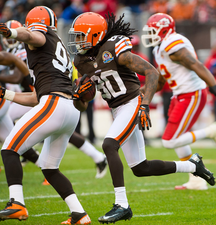 Description of . CLEVELAND, OH - DECEMBER 09: Wide receiver Travis Benjamin #80 of the Cleveland Browns runs for a touchdown during the first half against the Kansas City Chiefs at Cleveland Browns Stadium on December 9, 2012 in Cleveland, Ohio. (Photo by Jason Miller/Getty Images)