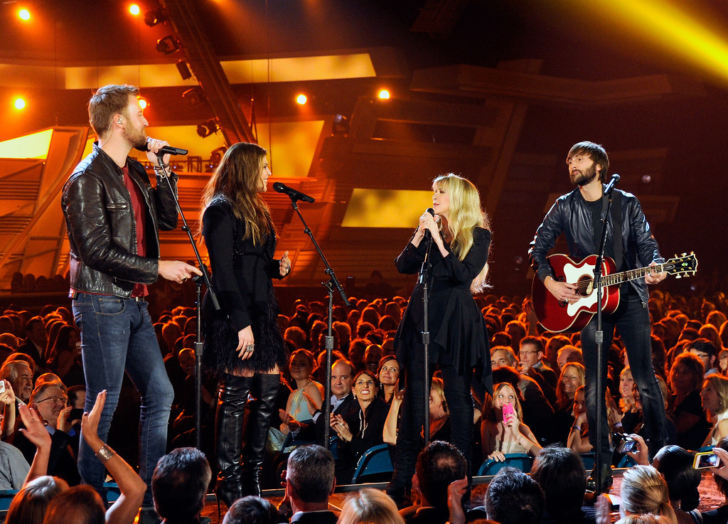 Description of . Singer Stevie Nicks (2nd L) performs with singers (L-R) Charles Kelley, Hillary Scott and Dave Haywood of Lady Antebellum onstage during the 49th Annual Academy Of Country Music Awards at the MGM Grand Garden Arena on April 6, 2014 in Las Vegas, Nevada.  (Photo by Ethan Miller/Getty Images)