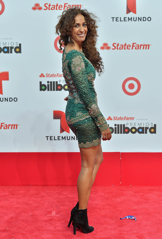 Description of . MIAMI, FL - APRIL 25:  Rosario Flores arrives at Billboard Latin Music Awards 2013 at Bank United Center on April 25, 2013 in Miami, Florida.  (Photo by Gustavo Caballero/Getty Images)