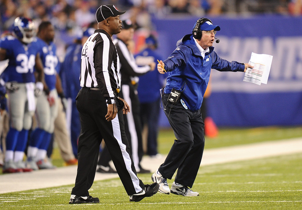 Description of . New York Giants head coach Tom Coughlin directs his team during the first half against the Green Bay Packers at MetLife Stadium on November 17, 2013 in East Rutherford, New Jersey.  (Photo by Maddie Meyer/Getty Images)