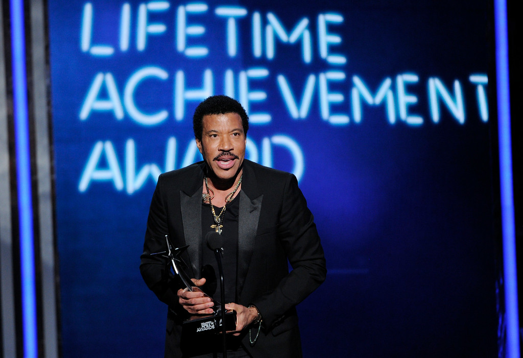 Description of . Lionel Richie accepts the lifetime achievement award at the BET Awards at the Nokia Theatre on Sunday, June 29, 2014, in Los Angeles. (Photo by Chris Pizzello/Invision/AP)