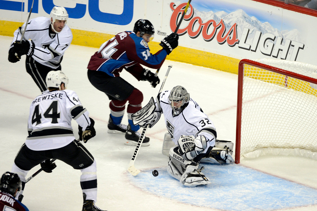 Description of . DENVER, CO. - JANUARY 22: Los Angeles Kings goalie Jonathan Quick (32) blocks a shot by Colorado Avalanche right wing David Jones (54) during a five-on-three power play for Colorado in the second period. The Colorado Avalanche hosted the Los Angeles Kings at the Pepsi Center on January, 22, 2013.   (Photo By John Leyba / The Denver Post)