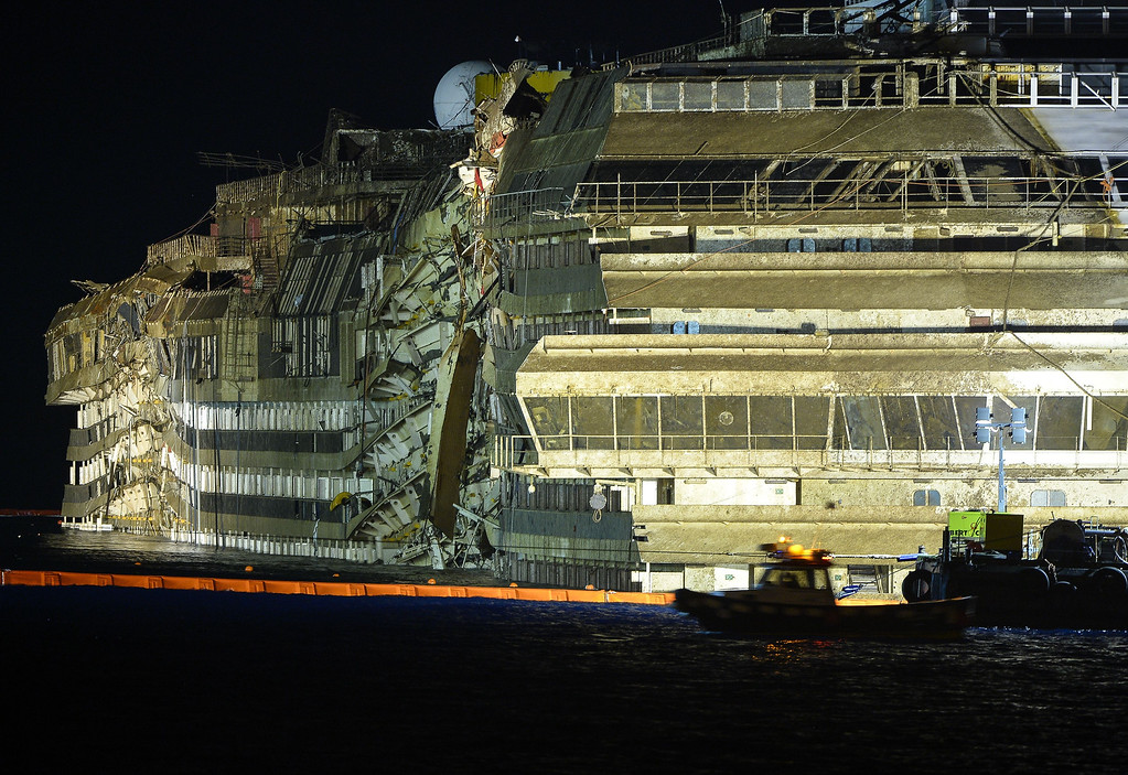 Description of . The wreck of Italy's Costa Concordia cruise ship sits upright on September 17, 2013 near the harbour of Giglio Porto. Salvage as orkers attempted to raise the cruise ship in the largest and most expensive maritime salvage operation in history, so-called