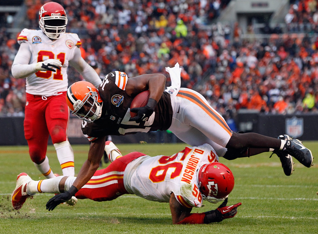 Description of . CLEVELAND, OH - DECEMBER 09:  Wide receiver Greg Little #15 of the Cleveland Browns dives for extra yardage over linebacker Derrick Johnson #56 of the Kansas City Chiefs as linebacker Tamba Hali #91 looks on at Cleveland Browns Stadium on December 9, 2012 in Cleveland, Ohio.  (Photo by Matt Sullivan/Getty Images)