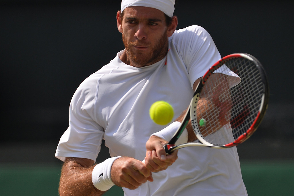 Description of . Argentina\'s Juan Martin Del Potro returns against Serbia\'s Novak Djokovicduring their men\'s singles semi-final match on day eleven of the 2013 Wimbledon Championships tennis tournament at the All England Club in Wimbledon, southwest London, on July 5, 2013. CARL COURT/AFP/Getty Images