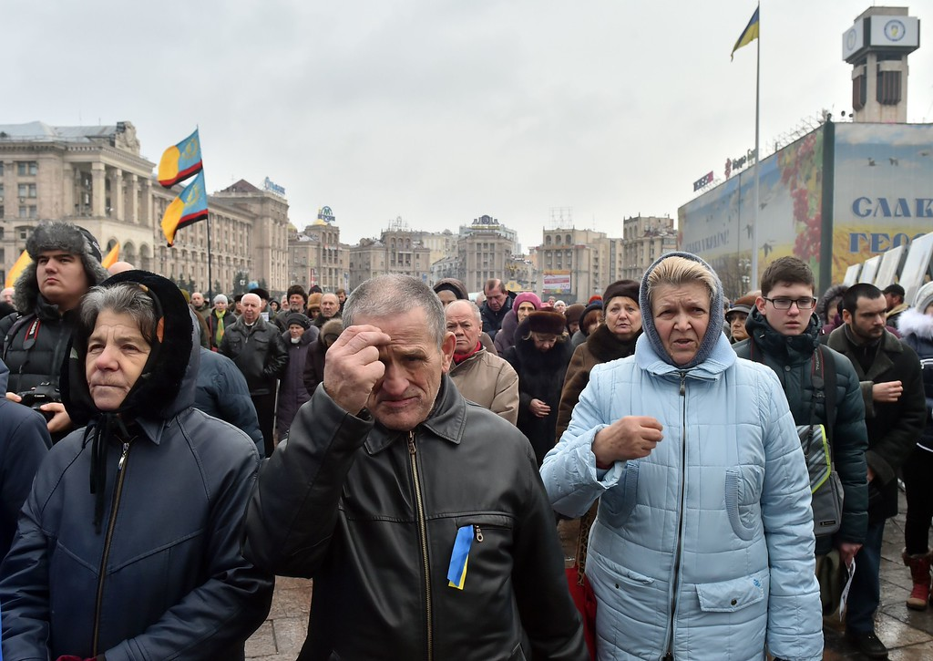 Description of . People crosses as they attend a rally for people who died as a result of shelling in the southern Ukrainian city of Mariupol, on January 25, 2015 on Independence Square in Kiev. At least 27 people died in a rocket attack on Ukraine's strategic government-held port of Mariupol after Russian-backed rebels rejected peace talks, the mayor's office said. SERGEI SUPINSKY/AFP/Getty Images
