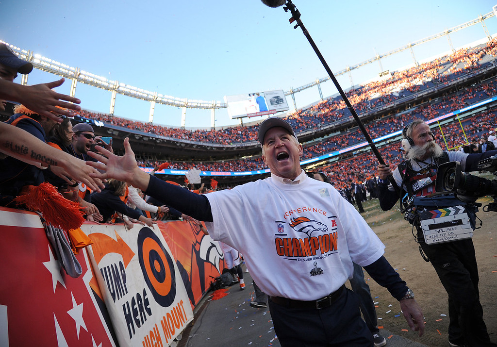 Description of . Denver Broncos head coach John Fox celebrates with fans after the game. The Denver Broncos take on the New England Patriots in the AFC Championship game at Sports Authority Field at Mile High in Denver on January 19, 2014. (Photo by Hyoung Chang/The Denver Post)