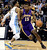 Los Angeles Lakers Metta World Peace (R) shoves Denver Nuggets Andre Iguodala (L) during their NBA basketball game in Denver, Colorado February 25, 2013.   REUTERS/Mark Leffingwell