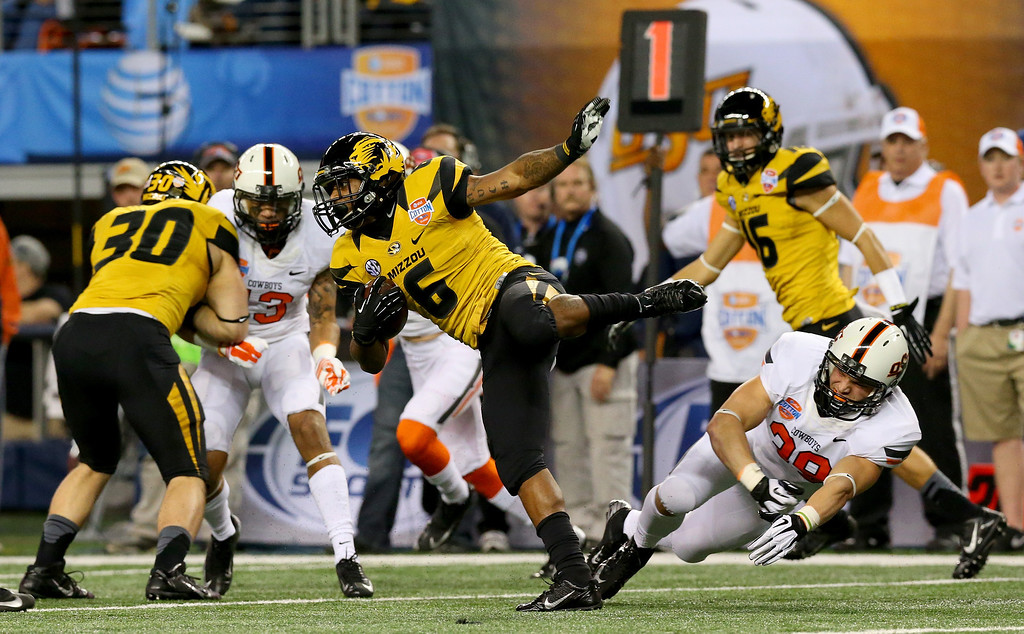 Description of . ARLINGTON, TX - JANUARY 03:  Marcus Murphy #6 of the Missouri Tigers returns a kick against the Oklahoma State Cowboys in the second half during the AT&T Cotton Bowl on January 3, 2014 in Arlington, Texas.  (Photo by Ronald Martinez/Getty Images)