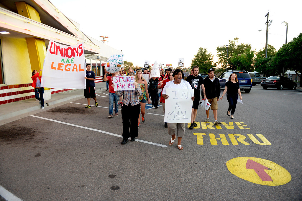 Description of . NORTHGLENN, CO-August, 2013: Protesters asking for better wages for fast food workers march outside a McDonald's in Northglenn, August 29, 2013. They are asking for $15 an hour for workers in this nationally organized event. (Photo By RJ Sangosti/The Denver Post)