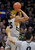 BOULDER, CO. - MARCH 7: Buffs point guard Spencer Dinwiddie (25) put up a jump shot over Oregon defender Jonathan Loyd (10) in the first half. The University of Colorado men's basketball team hosted Oregon Thursday night, March 7, 2013 at the CU Events Center in Boulder. (Photo By Karl Gehring/The Denver Post)