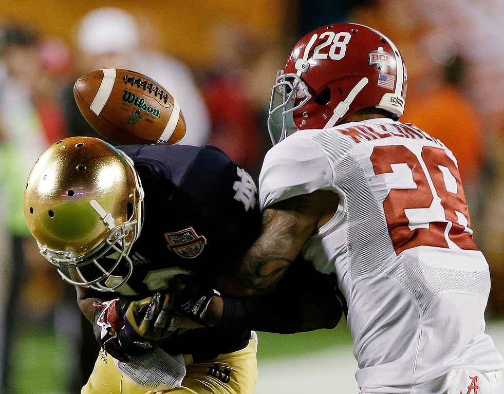 Description of . Alabama's Dee Milliner (28) breaks up a pass intended for Notre Dame's DaVaris Daniels during the first half of the BCS National Championship college football game Monday, Jan. 7, 2013, in Miami. (AP Photo/Chris O'Meara)