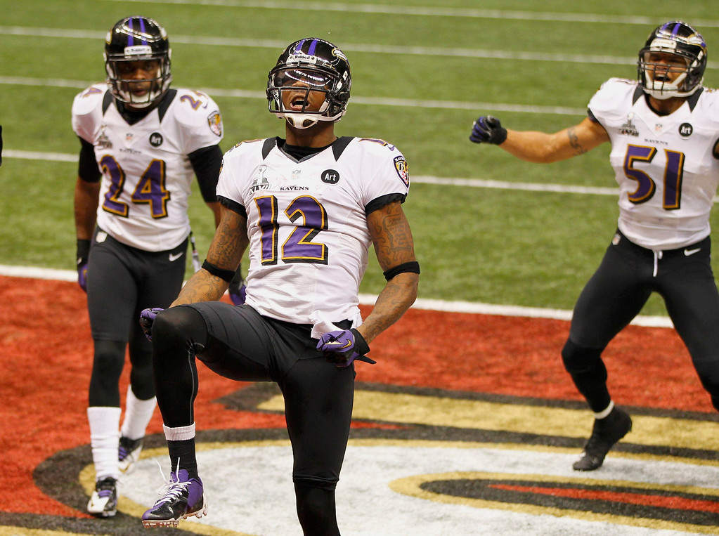Description of . Baltimore Ravens wide receiver Jacoby Jones (12) celebrates his second half kick-off run back touchdown against the San Francisco 49ers with temamates Corey Graham (24) and Brendon Ayanbadejo (51) in the NFL Super Bowl XLVII football game in New Orleans, Louisiana, February 3, 2013. REUTERS/Gary Hershorn