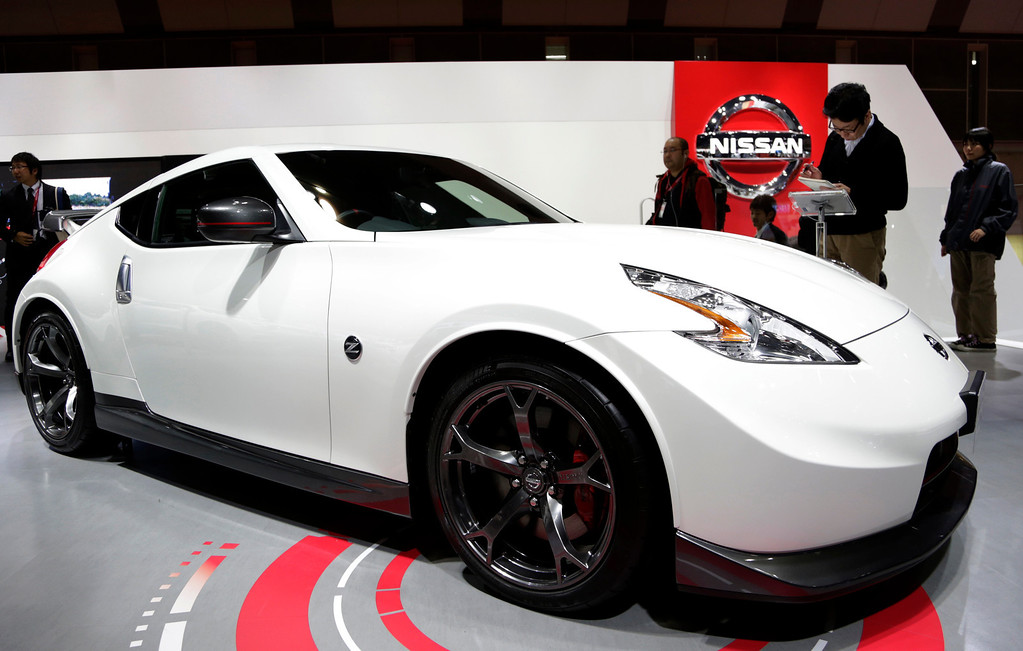 Description of . A Nissan Fairlady Z NISMO is displayed at the media preview for the Tokyo Motor Show at Tokyo Big Sight convention hall in Tokyo Wednesday, Nov. 20, 2013. (AP Photo/Shizuo Kambayashi)