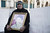 A Palestinian woman holding a photograph sits in protest outside the church of nativity before the official visit of U.S. President Barack Obama on March 22, 2013 in Bethlehem, West Bank.  (Photo by Ilia Yefimovich/Getty images)