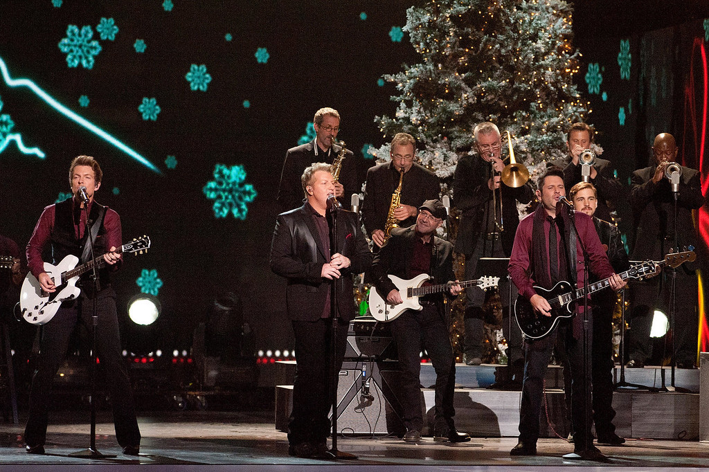 Description of . (L-R) Joe Don Rooney, Gary LeVox and Jay De Marcus of Rascal Flatts perform during the CMA 2013 Country Christmas on November 8, 2013 in Nashville, Tennessee.  (Photo by Erika Goldring/Getty Images)