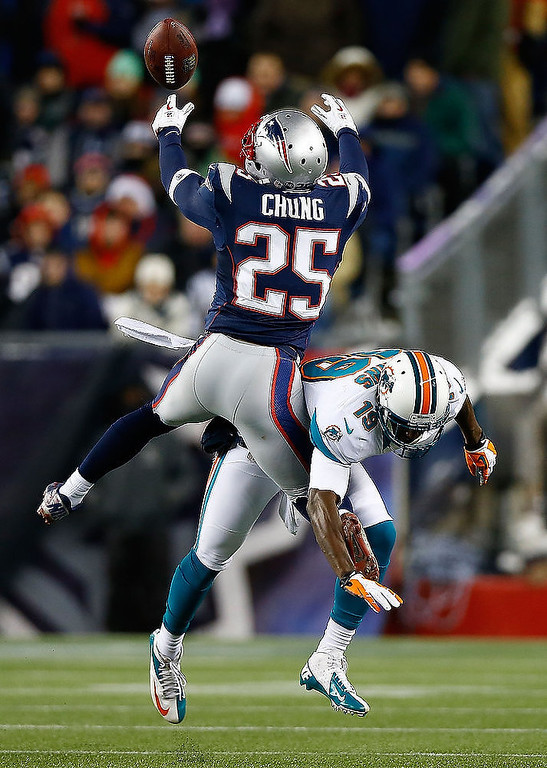Description of . Patrick Chung #25 of the New England Patriots breaks up a pass in front of Armon Binns #19 of the Miami Dolphins in the second half during the game at Gillette Stadium on December 30, 2012 in Foxboro, Massachusetts. (Photo by Jared Wickerham/Getty Images)