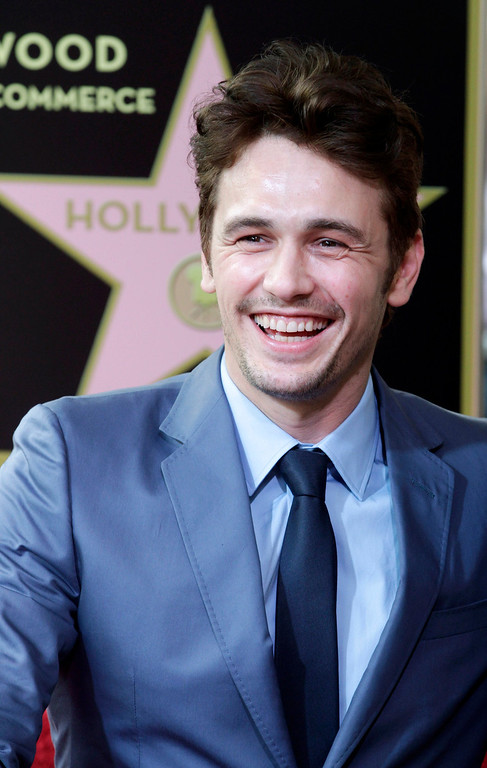 Description of . Actor James Franco smiles during ceremonies unveiling his star on the Hollywood Walk of Fame, in Hollywood March 7, 2013. REUTERS/Fred Prouser
