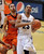 Spencer Dinwiddie of CU gets past Roberto Nelson of OSU during the second half of the March 9, 2013 game in Boulder.    (Cliff Grassmick/Boulder Daily Camera)