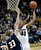 University of Colorado's Josh Scott takes a shot over Max Jacobsen during a game against Northern Arizona on Friday, Dec. 21, at the Coors Event Center on the CU campus in Boulder. (Jeremy Papasso/Daily Camera)
