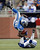 Detroit Lions running back Joique Bell (35) is upended by Indianapolis Colts cornerback Vontae Davis during the third quarter of an NFL football game at Ford Field in Detroit, Sunday, Dec. 2, 2012. (AP Photo/Rick Osentoski)
