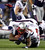 New England Patriots running back Stevan Ridley (22) dives ahead for a first down past the tackle of Houston Texans' Bradie James (53) during the second quarter of their NFL AFC Divisional playoff football game in Foxborough, Massachusetts January 13, 2013.     REUTERS/Jessica Rinaldi