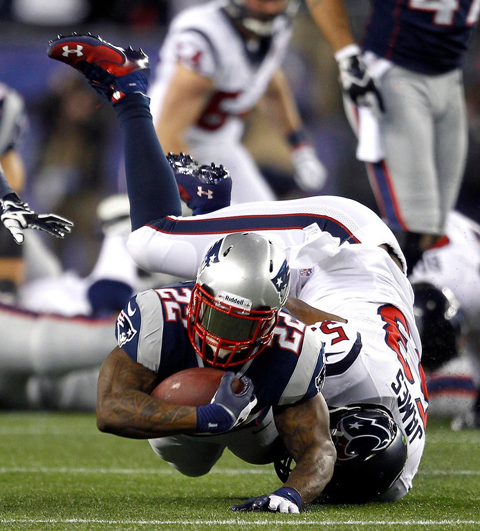 Description of . New England Patriots running back Stevan Ridley (22) dives ahead for a first down past the tackle of Houston Texans' Bradie James (53) during the second quarter of their NFL AFC Divisional playoff football game in Foxborough, Massachusetts January 13, 2013.     REUTERS/Jessica Rinaldi