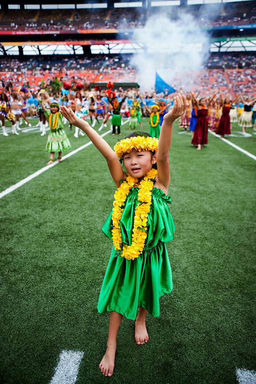 . A hula dancer performs before the NFL Pro Bowl football game in Honolulu, Sunday, Jan. 27, 2013. (AP Photo/Marco Garcia)