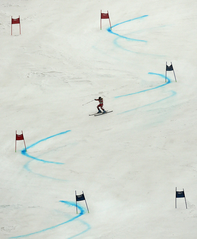 Description of . Lara Gut of Switzerland in action during the second run of the Women's Giant Slalom at the Rosa Khutor Alpine Center at the Sochi 2014 Olympic Games, Krasnaya Polyana, Russia, 18 February 2014.  EPA/JUSTIN LANE