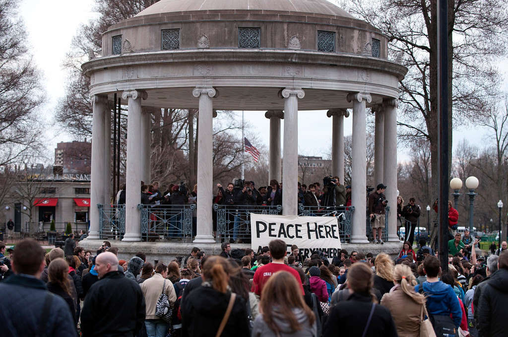 Description of . People gather in the Boston Commons for a vigil on April 16, 2013 in Boston, in the aftermath of two explosions that struck near the finish line of the Boston Marathon on April 15. Investigators said the range of suspects and motives in the grisly Boston bombings remained