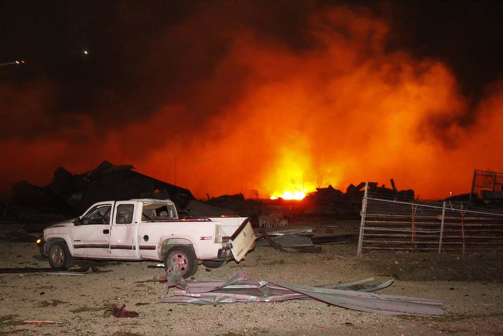 Description of . A fire burns at a fertilizer plant in West, Texas after an explosion Wednesday April 17, 2013. (APMichael Ainsworth/The Dallas Morning News)