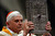 Germany's Cardinal Joseph Ratzinger, acting as substitute for the Pope, showes the gospel book during the celebration of the Easter Vigil service in Saint Peter's Basilica March 26, 2005 in Vatican City. Pope John Paul II remained in his private apartment as pilgrims speculated as to whether he will appear for Easter Sunday Mass in St Peter's Square.  (Photo by Franco Origlia/Getty Images)