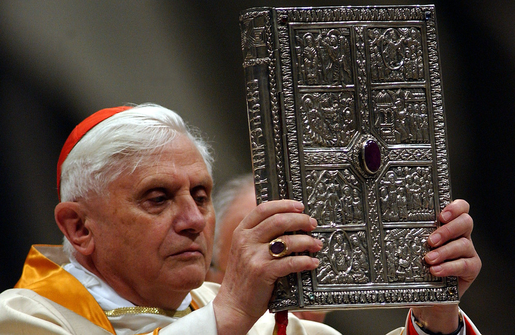 Description of . Germany's Cardinal Joseph Ratzinger, acting as substitute for the Pope, showes the gospel book during the celebration of the Easter Vigil service in Saint Peter's Basilica March 26, 2005 in Vatican City. Pope John Paul II remained in his private apartment as pilgrims speculated as to whether he will appear for Easter Sunday Mass in St Peter's Square.  (Photo by Franco Origlia/Getty Images)