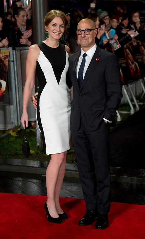 Description of . Stanley Tucci and Felicity Blunt arrive on the red carpet for the World Premiere of Hunger Games: Catching Fire, at a central London cinema, Monday, Nov. 11, 2013. (Photo by Joel Ryan/Invision/AP)