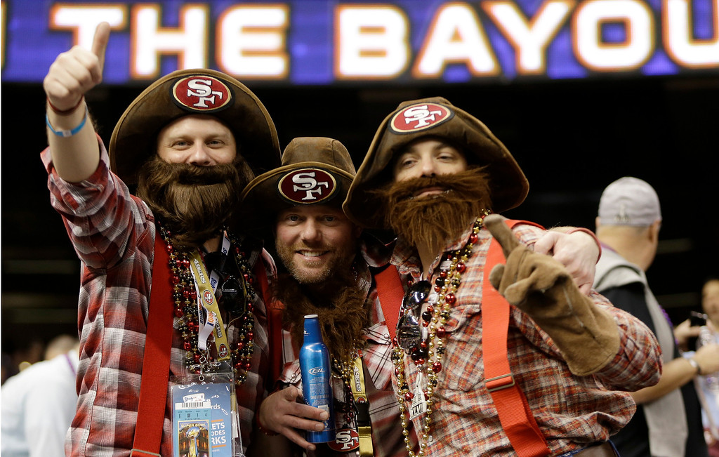 Description of . From left, San Francisco 49ers fans Vince Knoss, Ryan Knoss and Gibran Farrah, all of San Francisco, cheer before the NFL Super Bowl XLVII football game between the 49ers and the Baltimore Ravens, Sunday, Feb. 3, 2013, in New Orleans. (AP Photo/Mark Humphrey)