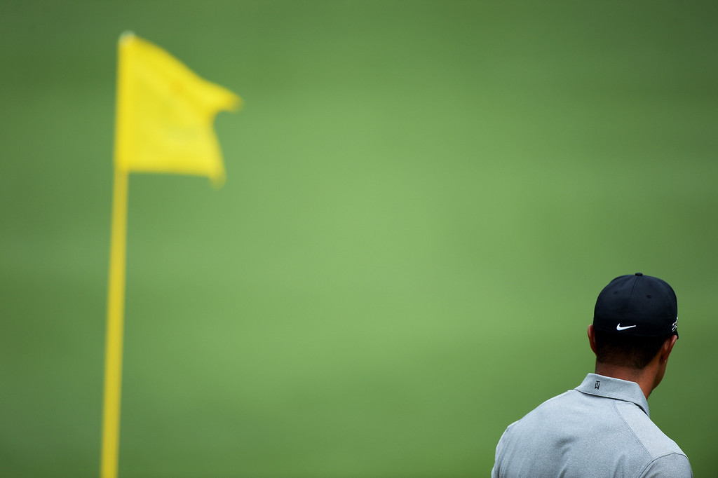 Description of . Tiger Woods of the United States looks at the green from the second hole during the first round of the 2013 Masters Tournament at Augusta National Golf Club on April 11, 2013 in Augusta, Georgia.  (Photo by Harry How/Getty Images)