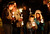 Mourners gather for a candlelight vigil at Ram's Pasture to remember shooting victims, Saturday, Dec. 15, 2012 in Newtown, Conn.  A gunman walked into Sandy Hook Elementary School in Newtown Friday and opened fire, killing 26 people, including 20 children. (AP Photo/Jason DeCrow)