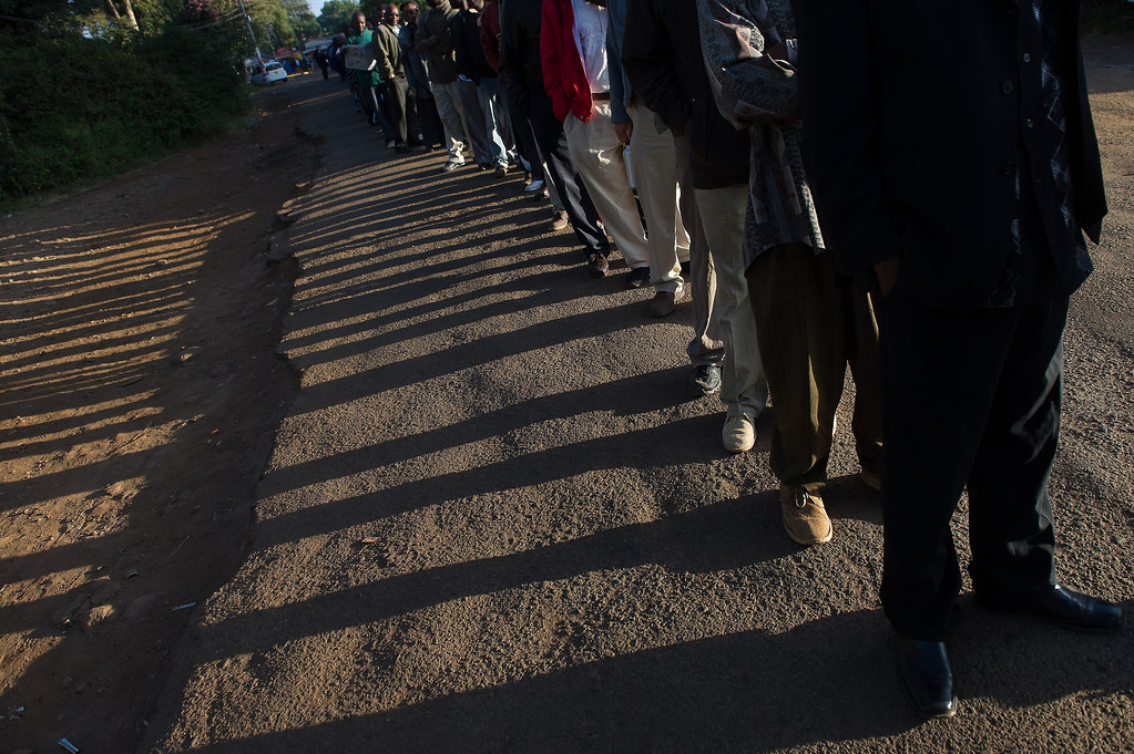 Description of . Voters queue to cast their ballot at St. Matthews church in the Langata constituency of the Kenyan capital, Nairobi, on March 4, 2013 during the elections. Long lines of Kenyans queued from far before dawn to vote Monday in the first election since the violence-racked polls five years ago, with a deadly police ambush hours before polling started marring the key ballot. The tense elections are seen as a crucial test for Kenya, with leaders vowing to avoid a repeat of the bloody 2007-8 post-poll violence in which over 1,100 people were killed, with observers repeatedly warning of the risk of renewed conflict .     PHIL MOORE/AFP/Getty Images