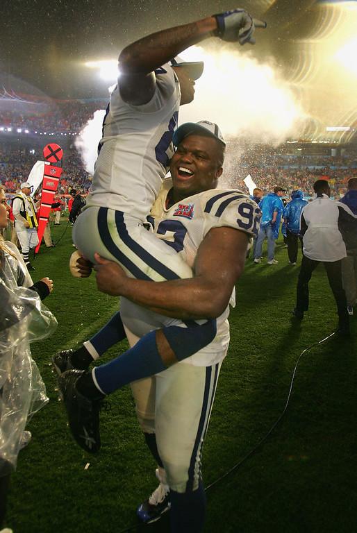Description of . Receiver Reggie Wayne #87 of the Indianapolis Colts is held-up on the shoulders of Anthony McFarland #92 as they celebrate a 29-17 win over the Chicago Bears in Super Bowl XLI on February 4, 2007 at Dolphin Stadium in Miami Gardens, Florida.  (Photo by Doug Pensinger/Getty Images)