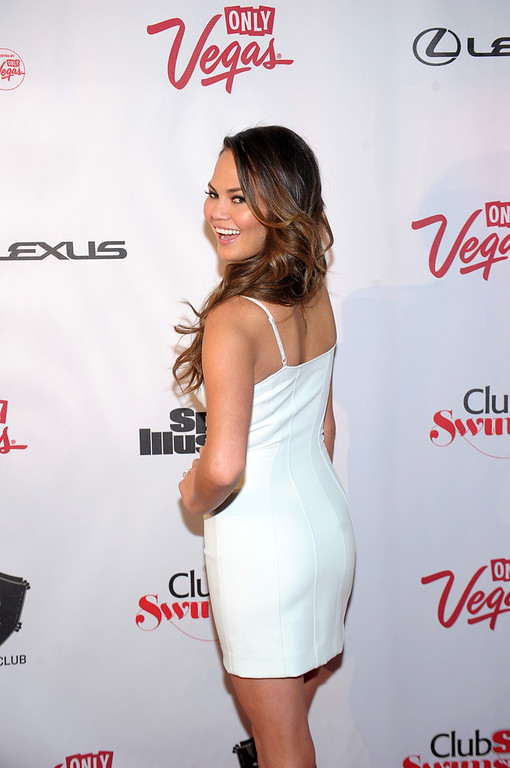 Description of . Sports Illustrated swimsuit model Chrissy Teigen attends Club SI Swimsuit at 1 OAK Nightclub at The Mirage Hotel & Casino on February 14, 2013 in Las Vegas, Nevada.  (Photo by Michael Loccisano/Getty Images for Sports Illustrated)