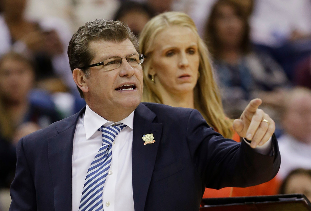 Description of . Connecticut head coach Geno Auriemma directs his team in the first half against Notre Dame at a women\'s NCAA Final Four college basketball tournament semifinal, Sunday, April 7, 2013, in New Orleans. (AP Photo/Dave Martin)