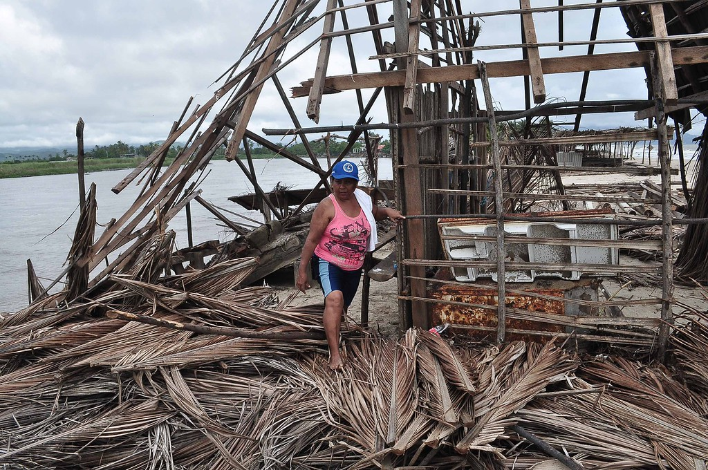 Description of . A resident of Barra de Coyuca checks the destruction in a restaurant by the beach in a tourist resort close to Acapulco, Guerrero state, Mexico  on September 19, 2013 as heavy rains hit the country.  AFP PHOTO/ Claudio VARGAS/AFP/Getty Images