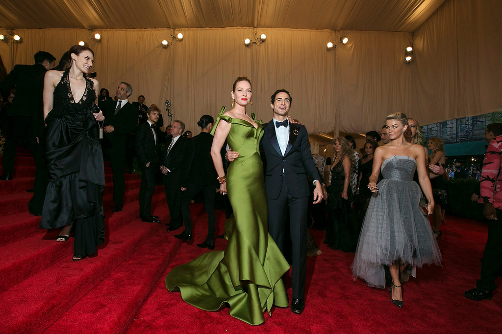 Description of . Actress Uma Thurman arrives with designer Zac Posen at the Metropolitan Museum of Art Costume Institute Benefit celebrating the opening of