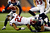 Arian Foster #23 of the Houston Texans stretches for a first down against Aqib Talib #31 of the New England Patriots during the 2013 AFC Divisional Playoffs game at Gillette Stadium on January 13, 2013 in Foxboro, Massachusetts.  (Photo by Jared Wickerham/Getty Images)